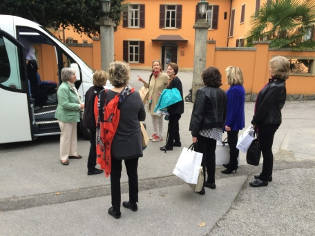 Departing the bus with a few shopping bags at the front of the villa