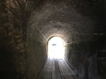 Inside the short funicular ride to Bergamo Alta